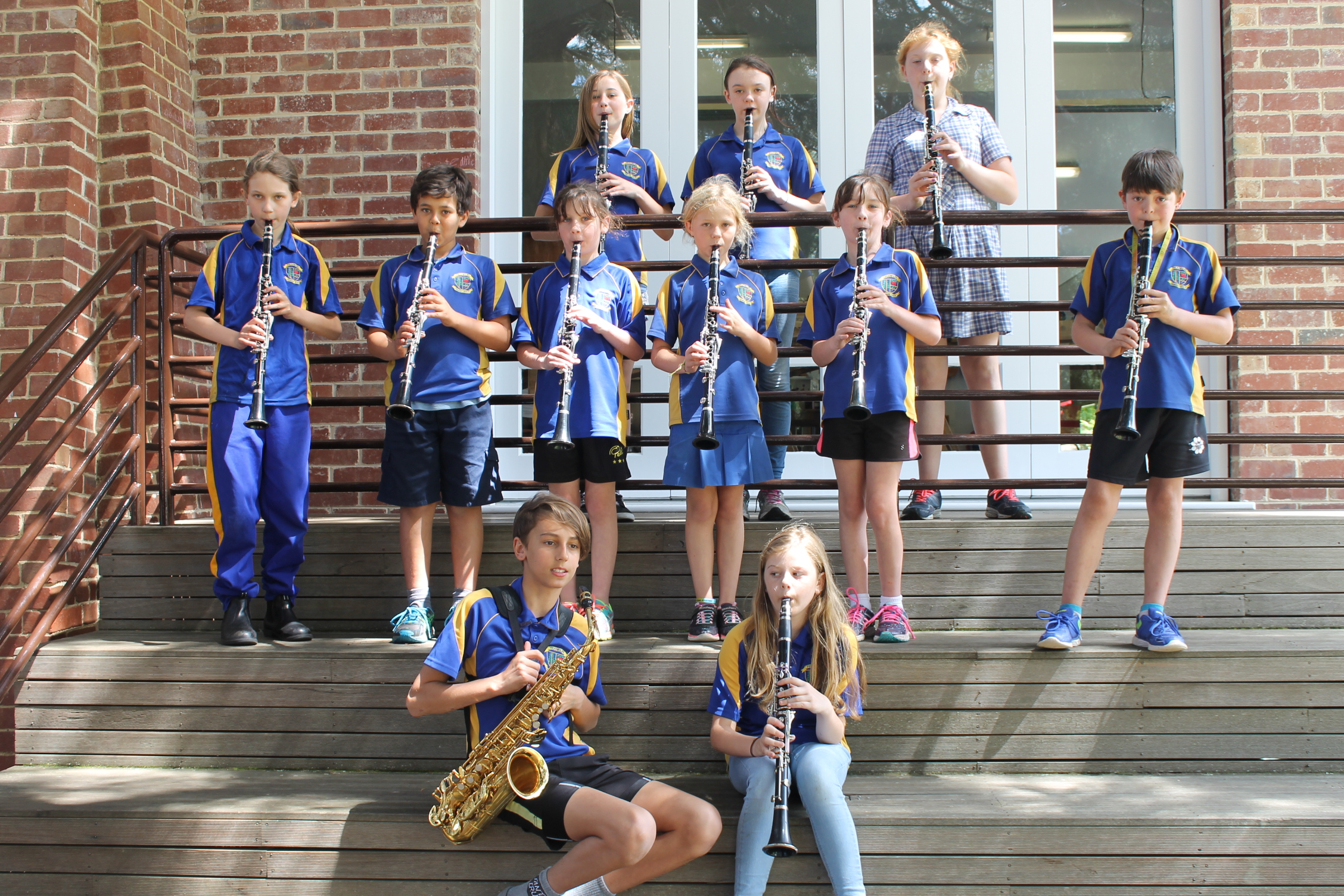 children playing instruments on stairs